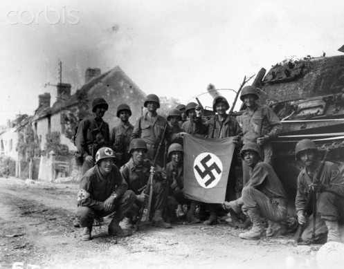 Soldiers Display a Captured Nazi Flag